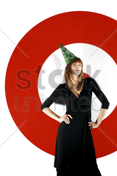 businesswoman wearing party hat stock photo