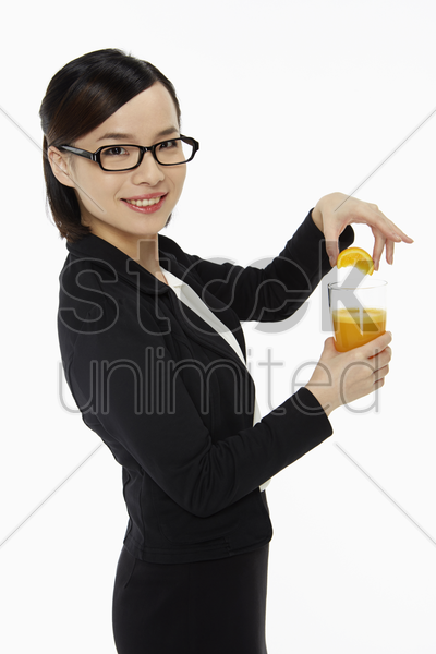businesswoman with a glass of orange juice stock photo