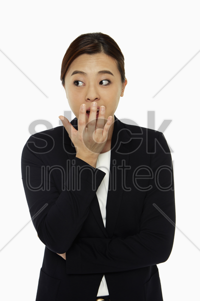 businesswoman with a shocked facial expression stock photo
