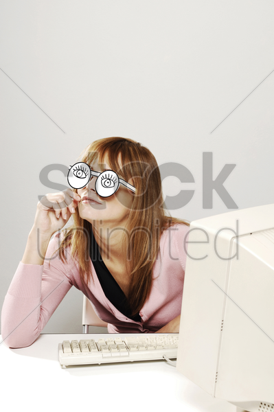 businesswoman with cardboard cut out spectacles thinking stock photo