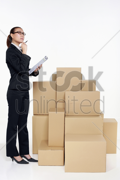 businesswoman with clipboard checking the goods stock photo