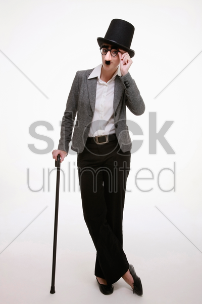 businesswoman with funny disguise and dance cane stock photo