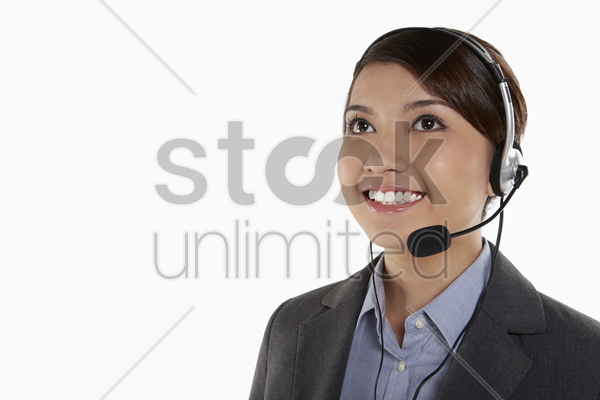 businesswoman with headset stock photo