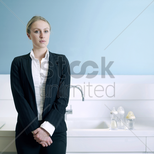 businesswoman with milk bottles on the sink stock photo