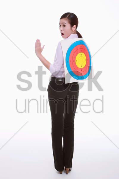 businesswoman with target on her back stock photo