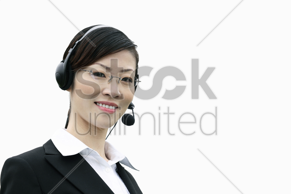 businesswoman with telephone headset stock photo