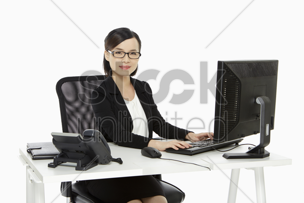 businesswoman working on a computer stock photo
