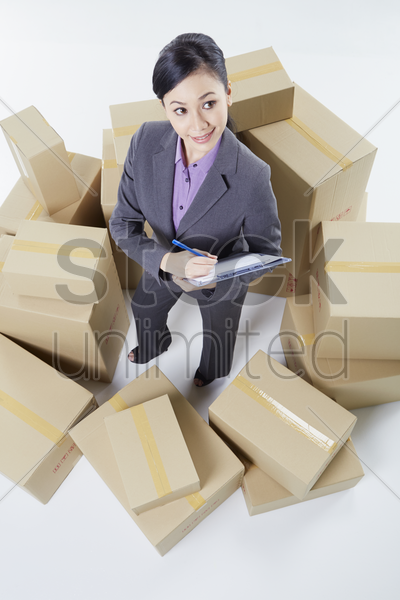 businesswoman writing in notepad stock photo