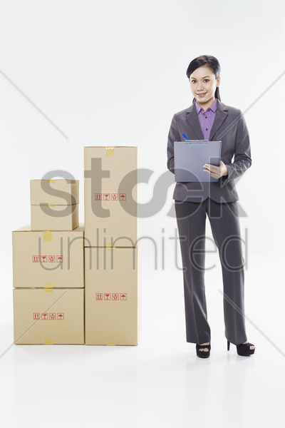 businesswoman writing on notepad stock photo