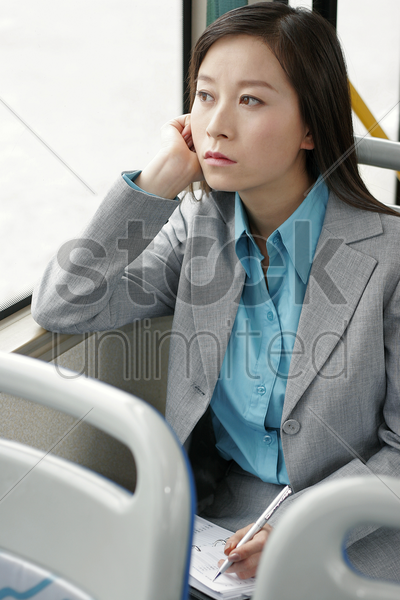 businesswoman writing organizer in the train stock photo