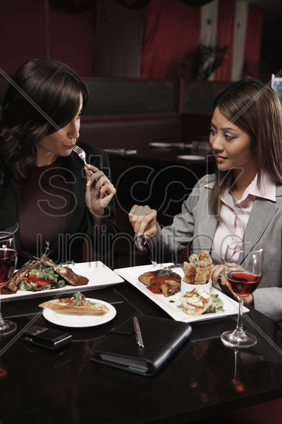 businesswomen having lunch together stock photo