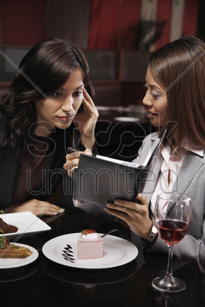 businesswomen looking at organizer stock photo