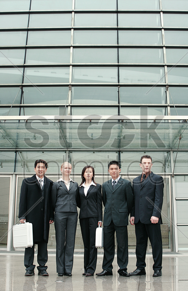 career men and women standing in a row stock photo