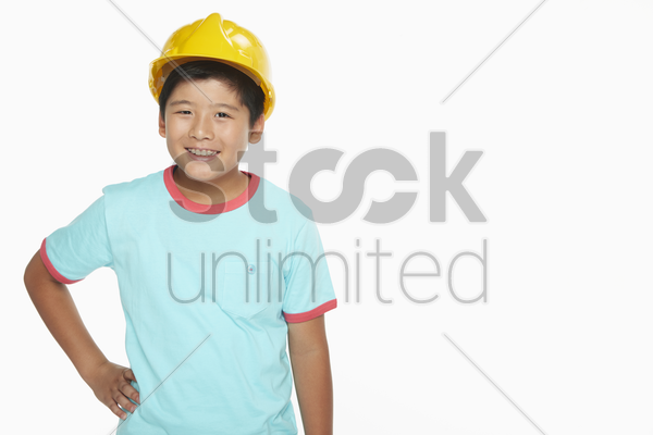 cheerful boy with a construction helmet stock photo