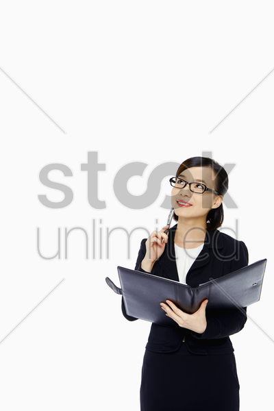 cheerful businesswoman contemplating stock photo