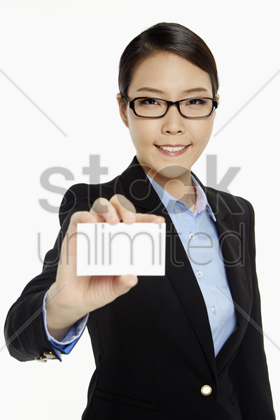cheerful businesswoman holding up a blank business card stock photo