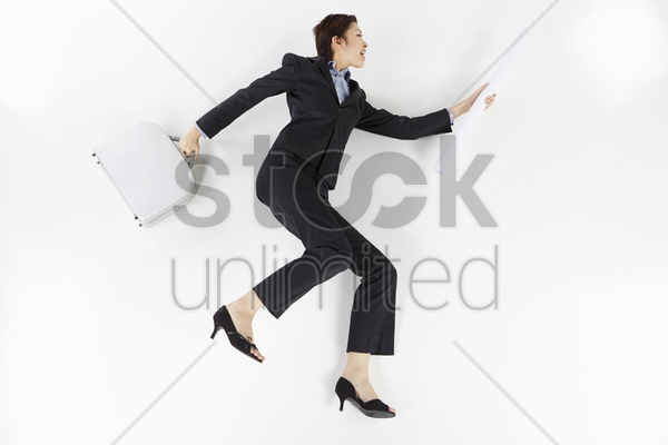 cheerful businesswoman posing on the floor stock photo