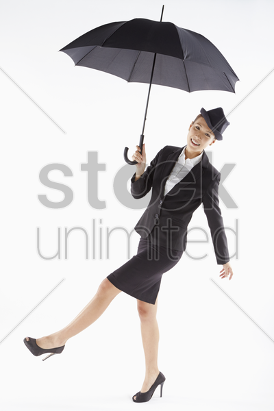 cheerful businesswoman posing with an umbrella stock photo