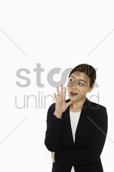 cheerful businesswoman shouting out stock photo