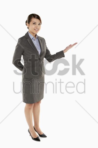 cheerful businesswoman showing hand gesture stock photo
