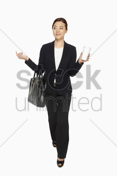 cheerful businesswoman with a drink stock photo