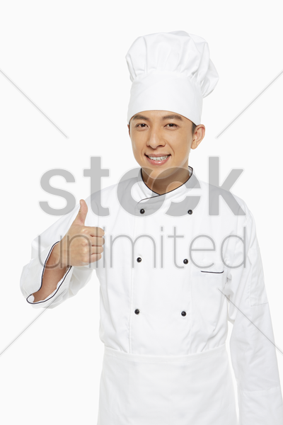 cheerful chef showing hand gesture stock photo