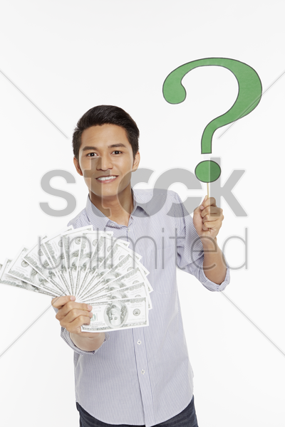 cheerful man holding a pile of cash stock photo