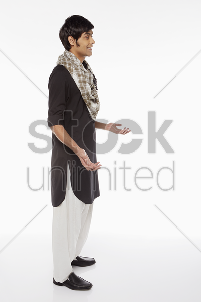 cheerful man in traditional clothing showing hand gesture stock photo