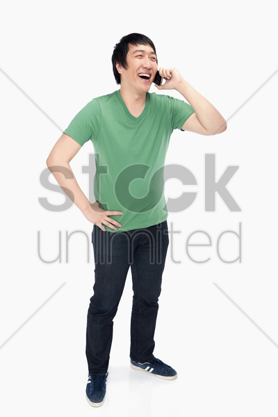 cheerful man talking on the phone stock photo