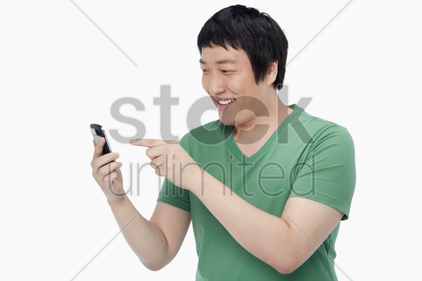 cheerful man text messaging with his mobile phone stock photo