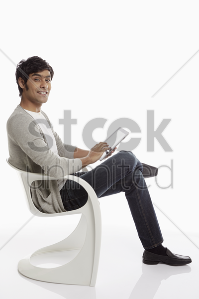 cheerful man using a digital tablet stock photo
