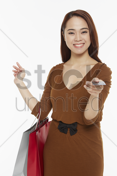 cheerful woman carrying shopping bags stock photo