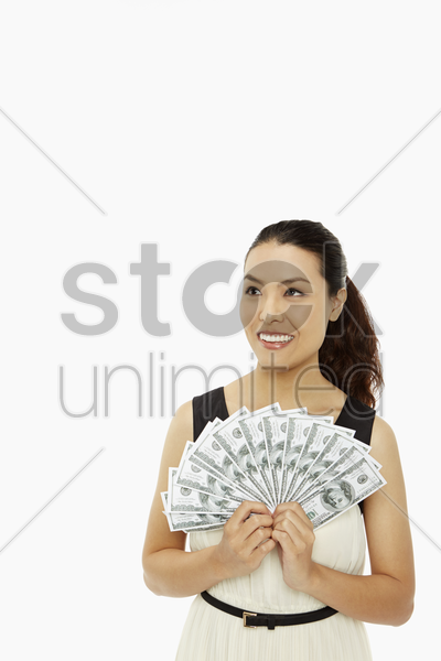 cheerful woman holding cash stock photo