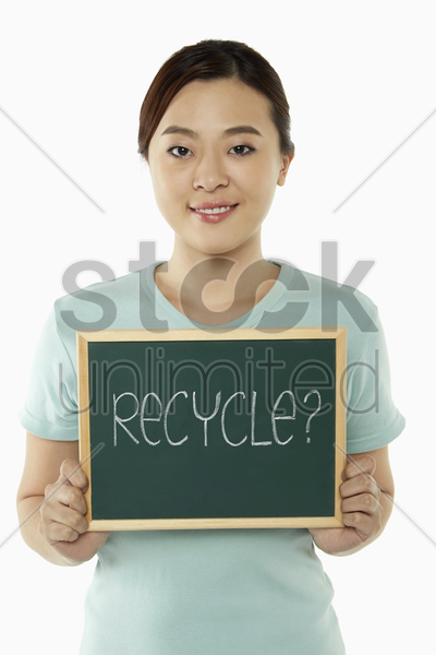 cheerful woman holding up a blackboard stock photo
