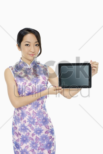 cheerful woman holding up a digital tablet stock photo