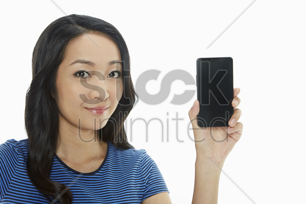 cheerful woman holding up a mobile phone stock photo