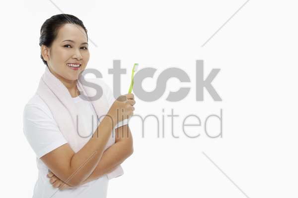 cheerful woman holding up a tooth brush stock photo