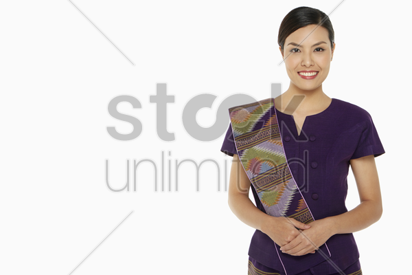 cheerful woman in traditional clothing smiling stock photo