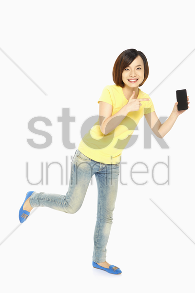cheerful woman pointing at the mobile phone stock photo