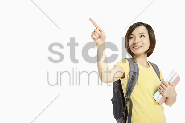 cheerful woman pointing to the right stock photo