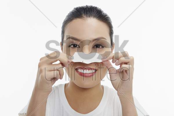 cheerful woman putting on a blackhead remover patch stock photo