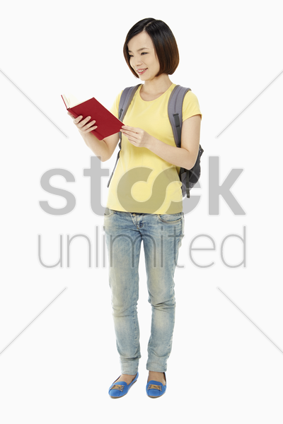cheerful woman reading a book stock photo
