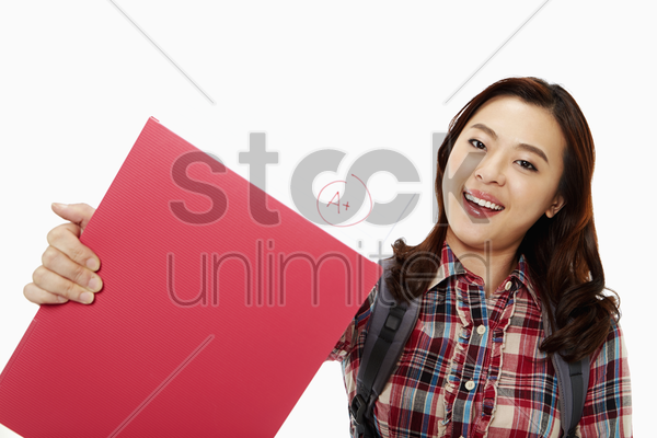 cheerful woman showing her good grades stock photo
