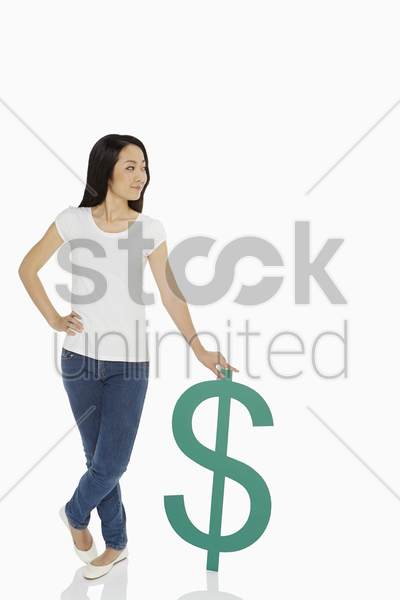 cheerful woman standing with a dollar sign stock photo