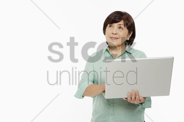 cheerful woman using a laptop stock photo