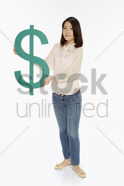 cheerful woman with a big dollar sign stock photo