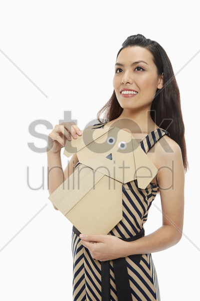 cheerful woman with a paper dog stock photo
