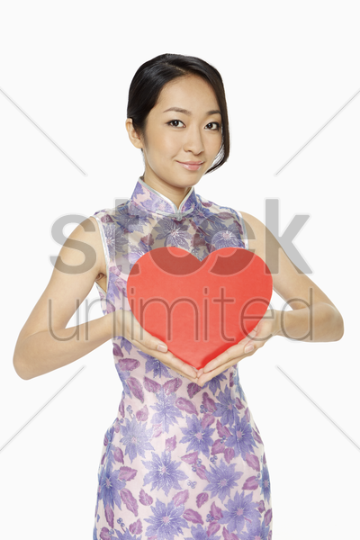 cheerful woman with a red heart stock photo