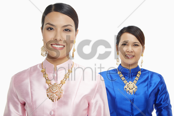 cheerful women in traditional clothing stock photo
