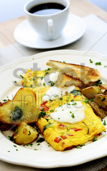 cheese and tomato omelette with black coffee stock photo